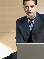 Businessman Using Laptop portrait