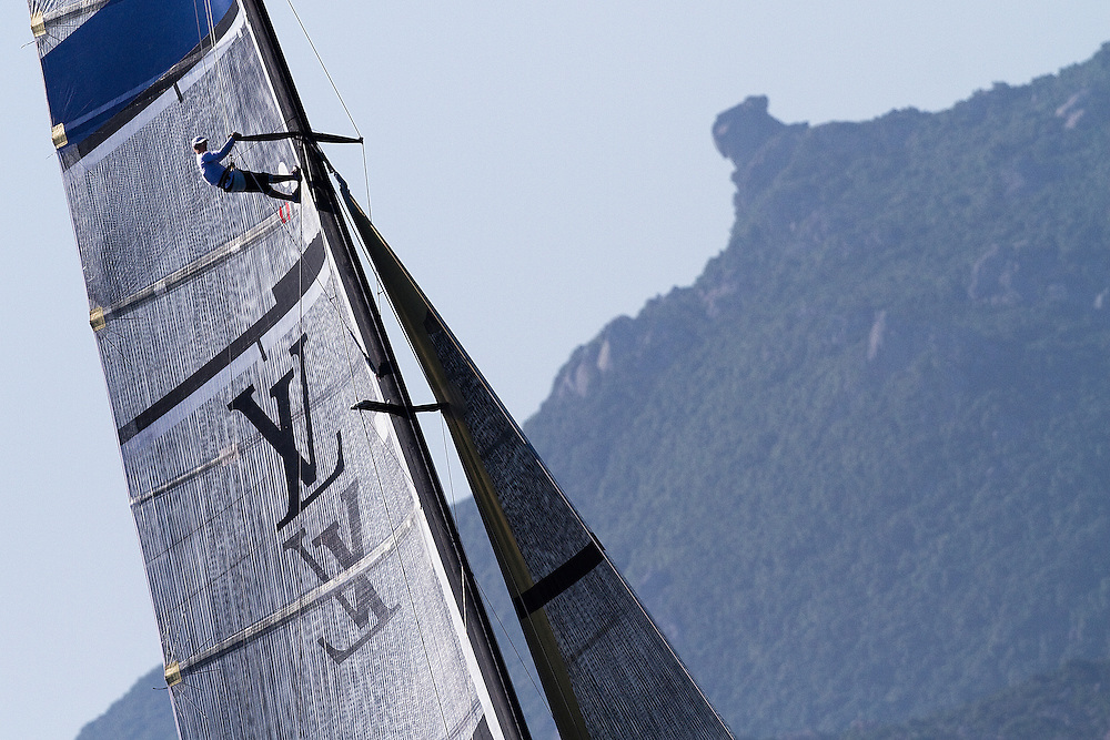 Strategist cameron Dunn looks for breeze from up the rig. Mascalzone Latino at the Louis Vuitton Trophy, La Maddalena, Italy. 1 June 2010. Photo: Gareth Cooke/Subzero Images