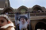 Egypt, Cairo. March 18, 2012 : Egyptian Christians mourn at the funeral of Pope Shenouda III, the head of Egypt's Coptic Orthodox Church, in the Abassiya Cathedral. Thousands of mourners gathered in Cairo for the funeral of Egypt's Orthodox Christian Pope Shenouda.