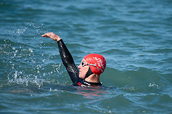 © London news pictures. 25/03/2017. Aberystwyth, UK.<br /> Members of 'Aber Swim Bike and Ride' group go for their first dip of the year in the sea on a  day of glorious sunshine and clear blue skies in Aberystwyth on the west wales coast, with temperatures expected to reach 18 or 19∫c by the afternoon. Sheltered from the cooling effects of an easterly wind, West Wales is expected to be the warmest pace in the UK today (Sat). Photo credit: Keith Morris/LNP