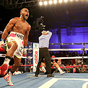John Correa celebrates his knock out of Alejandro Barbosa during a Telemundo boxing match at Osceola Heritage Park on Friday, July 20, 2018 in Kissimmee, Florida.  (Alex Menendez via AP)