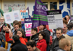© Licensed to London News Pictures. 31/10/2013.  Bristol, UK.  University staff go on strike over pay and hold a rally outside Senate House at the University of Bristol.  Members of UCU, Unison, and Unite are striking after rejecting a 1% pay offer.  They say their pay has declined by 13% since 2008, and that the university can afford to give them a bigger rise.  31 October 2013.<br /> Photo credit : Simon Chapman/LNP