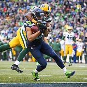 Seattle Seahawks player Jermaine Kearse catches a 35 yard pass from Russell Wilson for a game winning touchdown against the Green Bay Packers for the NFC Championship. The Seahawks won 28-22. Photographed on Sunday, January 18, 2015. (Joshua Trujillo, seattlepi.com)