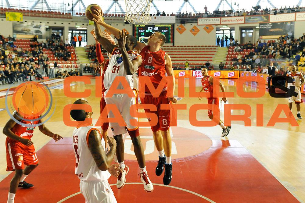 DESCRIZIONE : Roma Lega A 2012-13 Acea Virtus Roma Cimberio Varese<br /> GIOCATORE : Gani Lawal<br /> CATEGORIA : special rimbalzo<br /> SQUADRA : Acea Virtus Roma<br /> EVENTO : Campionato Lega A 2012-2013 <br /> GARA : Acea Virtus Roma Cimberio Varese<br /> DATA : 02/12/2012<br /> SPORT : Pallacanestro <br /> AUTORE : Agenzia Ciamillo-Castoria/GiulioCiamillo<br /> Galleria : Lega Basket A 2012-2013  <br /> Fotonotizia : Roma Lega A 2012-13 Acea Virtus Roma Cimberio Varese<br /> Predefinita :