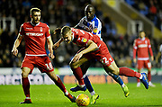 Nottingham Forest midfielder Ryan Yates (22) and Reading forward Modou Barrow (17) during the EFL Sky Bet Championship match between Reading and Nottingham Forest at the Madejski Stadium, Reading, England on 12 January 2019.
