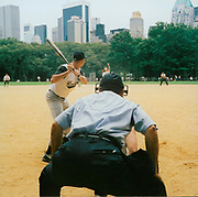 Group playing baseball on a field, USA, 1990's