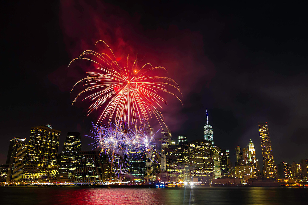 A surprise fireworks show over the New York City skyline on a Fall evening as seen from the Brooklyn Bridge Park.