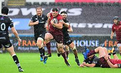 Munster's Robin Copeland is tackled by Ospreys' Dan Lydiate - Mandatory by-line: Craig Thomas/JMP - 16/09/2017 - RUGBY - Liberty Stadium - Swansea, Wales - Ospreys Rugby v Munster Rugby - Guinness Pro 14