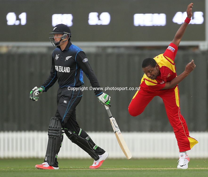 Tinashe Panyangara of Zimbabwe bowling and Martin Guptill of the Black Caps at the non-stricker end during the ICC Cricket World Cup warm up game between the Black Caps v Zimbabwe at Bert Sutcjliffe Oval, Lincoln, Christchurch. 9 February 2015 Photo: Joseph Johnson / www.photosport.co.nz