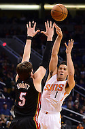 Jan 3, 2017; Phoenix, AZ, USA;  Phoenix Suns guard Devin Booker (1) makes a pass over Miami Heat forward Luke Babbitt (5) in the first half of the NBA game at Talking Stick Resort Arena. The Suns won 99-90. Mandatory Credit: Jennifer Stewart-USA TODAY Sports