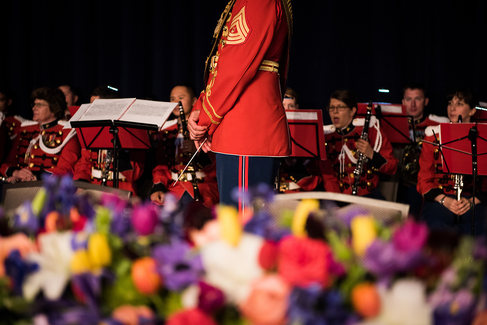 The conductor of the United States Marine Band is seen behind the head table of the White House Correspondents' Dinner in Washington, D.C. on April 29, 2017. CREDIT: Mark Kauzlarich for CNN
