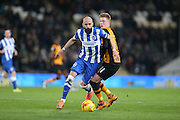 Brighton defender, Bruno Saltor (2) goes past Hull City midfielder Sam Clucas (11) during the Sky Bet Championship match between Hull City and Brighton and Hove Albion at the KC Stadium, Kingston upon Hull, England on 16 February 2016.
