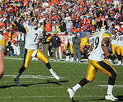 DENVER - JANUARY 22:  Quarterback Ben Roethlisberger #7 of the Pittsburgh Steelers unloads a 17 yard touchdown pass to teammate Hines Ward #86 in the AFC championship game against the Denver Broncos on January 22, 2006 at INVESCO Field at Mile High in Denver, Colorado. The Steelers defeated the Broncos 34-17. ©Paul Anthony Spinelli *** Local Caption *** Ben Roethlisberger