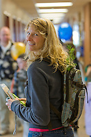 A fir tree seedling, from a traveling Science World exhibit is carried in a woman's backpack at the North Island Campus in Campbell River. Vancouver Island, British Columbia, Canada.