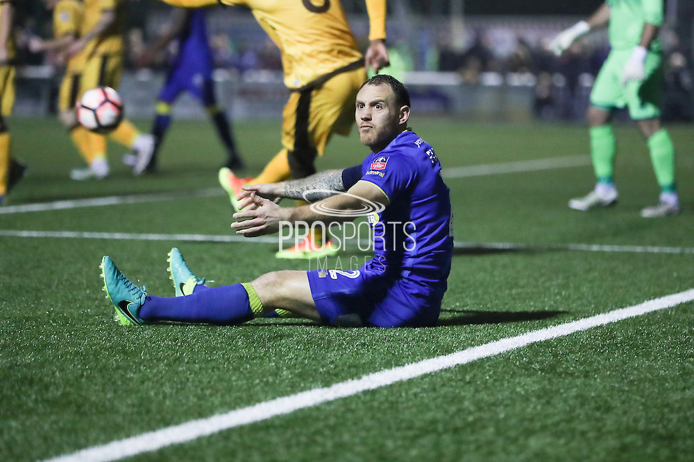 AFC Wimbledon defender & captain Barry Fuller (2)  looks for the penalty during The FA Cup match between Sutton United and AFC Wimbledon at Gander Green Lane, Sutton, United Kingdom on 7 January 2017. Photo by Stuart Butcher.