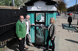 Scottish Green party candidates for the Lothians Alison Johnstone (right) and Andy Wightman (left) officially unveil the latest piece of art by Leith-based artist Stewart Bremner (centre), a specially-designed and painted decommissioned police box on Leith Walk, Edinburgh.<br /> <br /> <br /> &copy; Dave Johnston/ EEm