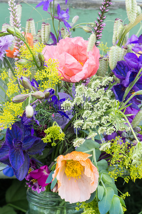 Flower arrangement with: Salvia viridis, Blue Cornflowers, Ammi, Briza maxima, Cerinthe, Dill, Delphinium consolida 'True wild form' and Papaver nudicaule 'Wind Song'