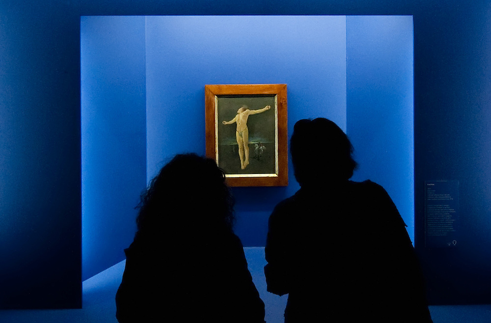 MILAN, ITALY - SEPTEMBER 21:  Visitors admire an oil painting by Salvador Dali at the Exhibition preview at Palazzo Reale on September 21, 2010 in Milan, Italy. Dali is back in Milan with Il sogno si avvicina, an exhibition that takes place at Palazzo Reale  and that focus on the relationship between the great Spanish artist's visions and his favourite themes:  landscape, dream and desire.