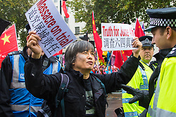 Whitehall, London, October 21st 2015. Dr Shao Jiang, a survivor of Tiananmen Square and no Amnesty International activist protests outside Downing Street ahead of Chinese President Xi Jinpeng' s arrival. He was later arrested outside Mansion House where President Xi was attending a reception.