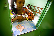 Konaté Fatouma pays for her prescription at the pharmacy of the NDA health center in Dimbokro, Cote d'Ivoire on Friday June 19, 2009.