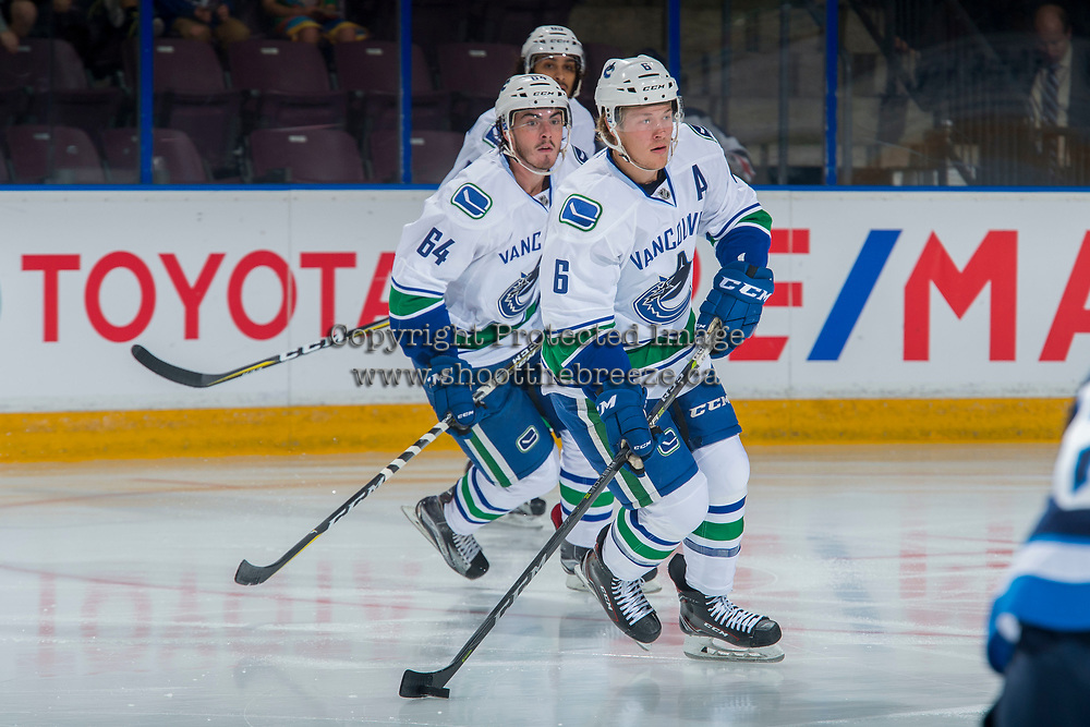 PENTICTON, CANADA - SEPTEMBER 8: Zack MacEwan #64 and Brock Boeser #6 of Vancouver Canucks skate against the Winnipeg Jets on September 8, 2017 at the South Okanagan Event Centre in Penticton, British Columbia, Canada.  (Photo by Marissa Baecker/Shoot the Breeze)  *** Local Caption ***