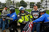 Demonstrators representing U.S. veterans' groups, angered over the closing of war memorials during the 2013 federal government shutdown, clash with police in front of the White House.