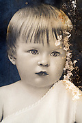head shot studio portrait of a toddler France ca 1920s