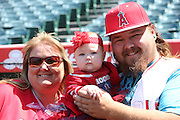 ANAHEIM, CA - APRIL 30:  A family of Los Angeles Angels of Anaheim fans pose for a photo with their baby before the Los Angeles Angels of Anaheim game against the Cleveland Indians at Angel Stadium on Wednesday, April 30, 2014 in Anaheim, California. The Angels won the game 7-1. (Photo by Paul Spinelli/MLB Photos via Getty Images)