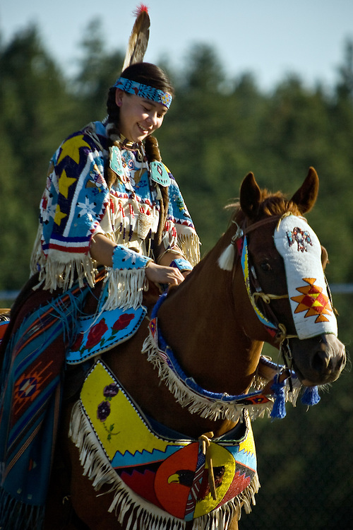 JEROME A. POLLOS/Press..Danika Pimms, a Yakima Tribal member from White Swan, Ore., prepares her horse, Napoleon, for the Powwow.