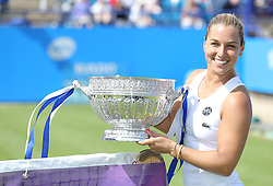 Dominika Cibulkova of Slovakia celebrates as she lifts the trophy after winning the Aegon International Eastbourne singles tournament by beating Karolina Pliskova ( not pictured ) of Czech Republic  - Mandatory by-line: Paul Terry/JMP - 25/06/2016 - TENNIS - Devonshire Park - Eastbourne, United Kingdom - Dominika Cibulkova v Karolina Pliskova - Aegon International Eastbourne