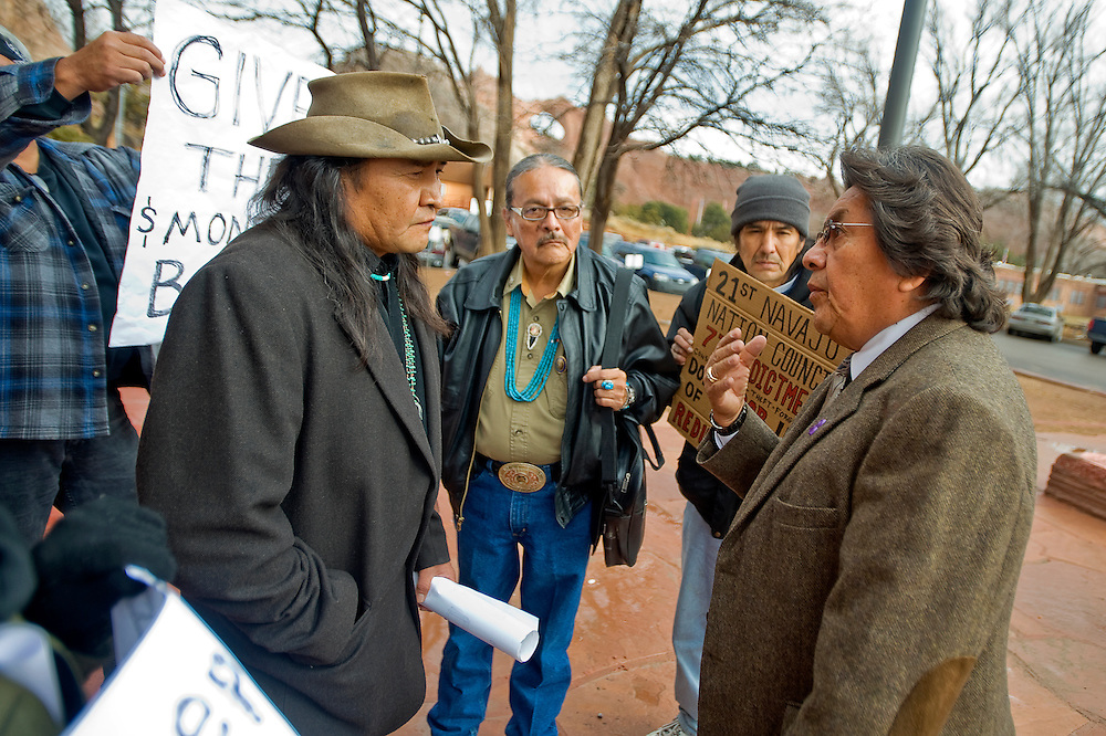 122210      Brian Leddy.Norman Patrick Brown and Navajo Nation Council Delegate Francis Redhouse argue in front of the Navajo Nation Council Chambers on Wednesday.