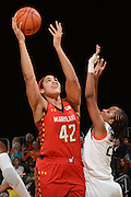 February 13, 2014: Brionna Jones #42 of Maryland shoots over Adrienne Motley #23 of Miami during the NCAA basketball game between the Miami Hurricanes and the Maryland Terrapins at the Bank United Center in Coral Gables, FL. The Terrapins defeated the Hurricanes 67-52.