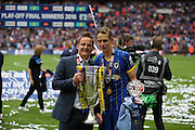 AFC Wimbledon manager Neal Ardley and AFC Wimbledon defender Paul Robinson (6) celebrating promotion at the end of the Sky Bet League 2 play off final match between AFC Wimbledon and Plymouth Argyle at Wembley Stadium, London, England on 30 May 2016.