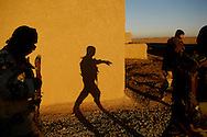 Iraqi army soldiers walk to the next house in the Qubbah village, Iraq, Feb., 2, 2007 during Operation Lightning. Operation Lightning is an Iraqi army planned operation looking for weapon cache, personnel of high interest and gathering of intelligence with the help of the U.S. Army Soldiers from Forward Operating Base McHenry, soldiers are from 2nd Battalion, 27th Infantry Regiment, 3rd Brigade Combat Team, 25th Infantry Division, Schofield Barracks, Hawaii. The Iraqi soldier is assigned to the 1st Battalion, 2nd Brigade, 4th Infantry. (