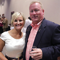 Brandy Parker, left, and John Munroe pose for a photo Saturday September 20, 2014 during the 4th Annual Care Project Gala at Union Station in Wilmington, N.C. (Jason A. Frizzelle)