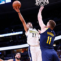 03 April 2018: Denver Nuggets guard Jamal Murray (27) goes for the layup against Indiana Pacers center Domantas Sabonis (11) during the Denver Nuggets 107-104 victory over the Indiana Pacers, at the Pepsi Center, Denver, Colorado, USA.