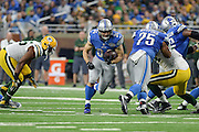 DETROIT, MI - JANUARY 01: Lions running back Zach Zenner (34) finds a hole during a NFC North NFL football game between Detroit and Green Bay on January 1, 2017, at Ford Field in Detroit, MI. (Photo by Adam Ruff/Icon Sportswire)