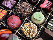 Life is like a box of chocolates.  Close up photo of gourmet chocloate.  © Audrey C. Tiernan