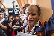 28 APRIL 2014 - BANGKOK, THAILAND: A man in grief tries to reach the coffin during the funeral for Kamol Duangphasuk, 45, in Bangkok. Kamol was a popular poet who wrote under the pen name Mai Nueng Kor Kunthee. Kamol had been writing since the 1980s and was an outspoken critic of the 2006 coup that deposed Thaksin Shinawatra. After the 2010 military crackdown against the Red Shirts he went into temporary self imposed exile fearing for his safety. After he returned to Thailand he organized weekly protests against Thailand's Lese Majeste laws, which he said were being used to stifle dissent. Kamol was shot and murdered on April 23. The assailants are still at large but the murder is thought to be political.     PHOTO BY JACK KURTZ