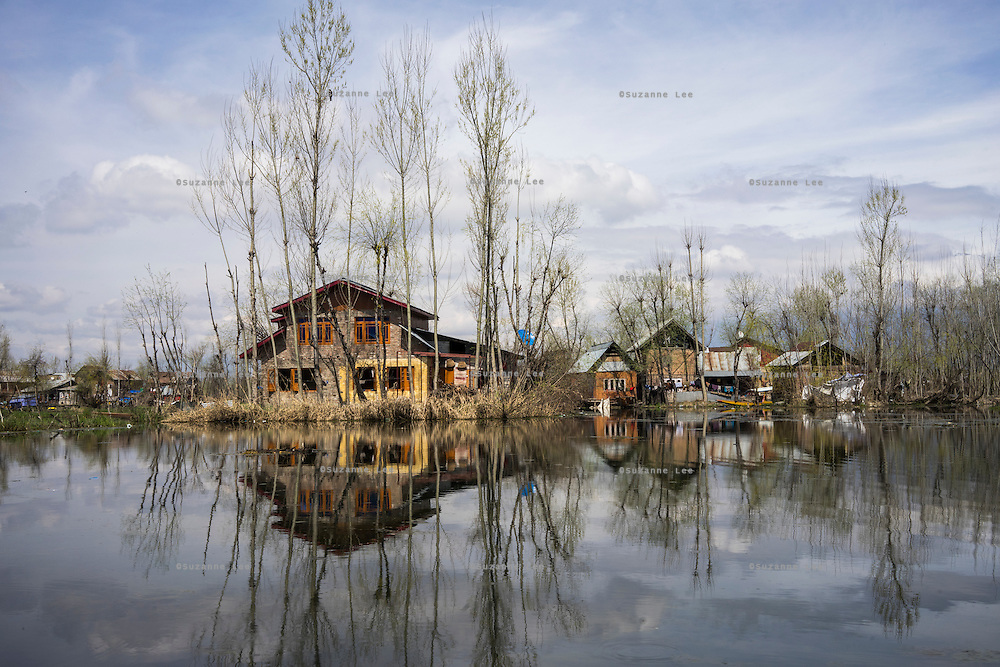 General views of destroyed properties in Abikarpora village on the Dal Lake, Srinagar, Jammu and Kashmir, India, on 25th March 2015. Nearly 2500 villagers including Srinagar, the capital of the state of Jammu and Kashmir, was devastated by severe floods and landslides in September 2014 the worst in 60 years, displacing millions of people, many of them children. Photo by Suzanne Lee for Save the Children