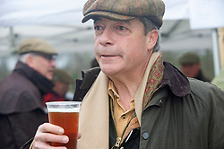 ©Licensed to London News Pictures 26/12/2019. <br /> Chiddingstone ,UK. Nigel Farage enjoying a Boxing day pint. Nigel Farage (Brexit party Leader) attending Old Surrey Burstow and West Kent Boxing day hunt at Chiddingstone.  Photo credit: Grant Falvey/LNP