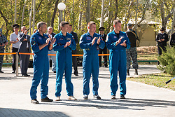 At their Cosmonaut Hotel crew quarters in Baikonur, Kazakhstan, the Expedition 57 prime and backup crewmembers applaud during traditional pre-launch flag raising ceremonies Sept. 27. From left to right are backup crewmembers David Saint-Jacques of the Canadian Space Agency and Oleg Kononenko of Roscosmos and prime crewmembers Alexey Ovchinin of Roscosmos and Nick Hague of NASA. Ovchinin and Hague of will launch Oct. 11 on the Soyuz MS-10 spacecraft from the Baikonur Cosmodrome in Kazakhstan for a six-month mission on the International Space Station.<br /> <br /> NASA/Victor Zelentsov