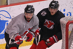May 29; Newark, NJ, USA; New Jersey Devils left wing Ilya Kovalchuk (17) and New Jersey Devils defenseman Anton Volchenkov (28) during Stanley Cup Finals media practice day at the Prudential Center.