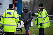 UNITED KINGDOM, Popham Service Station: 22 January 2019. What is thought to be illegal immigrants are taken off an articulated lorry after being pulled over at the Popham Services on the A303. It is believed that there were seven of them in the back of the truck.<br /> Rick Findler