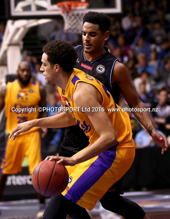 Breakers` Corey Webster challenges Kings` Michael Bryson in the Round 3 ANBL Basketball Match, New Zealand Breakers v Sydney Kings, North Shore Events Centre, Auckland, New Zealand, Thursday, October 20, 2016. Copyright photo: David Rowland / www.photosport.nz