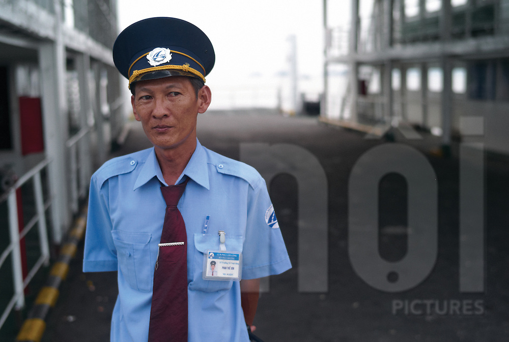 Phan The Son, ferry pilot at the Vam Cong Ferry terminal near Long Xuyen, An Giang province, Vietnam, Southeast Asia