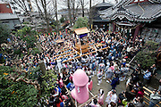 """Participants carry a portable shrine on which is mounted a 2.5 meter pink phallus and a a smaller black one made from stone in the grounds of Wakamya Hachimangu shrine during the Kanamara Festival in Kawasaki, Japan on 04 April 2010. The fertility festival, often just called the """"penis festival,"""" has been held since the early 1600s and also aims to promote awareness of AIDS and STDs.."""