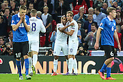 England's Theo Walcott celebrates his goal with Harry Kane during the UEFA European 2016 Qualifier match between England and Estonia at Wembley Stadium, London, England on 9 October 2015. Photo by Shane Healey.