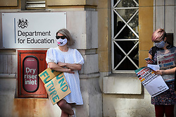 © Licensed to London News Pictures. 20/08/2020. LONDON, UK.  Jo Grady (L), General Secretary UCU, join students at a protest outside the Department for Education in Westminster calling for a full review into grade inequality following this year's exam results chaos.  After a campaign for A-Level and GCSE students to have grades based on teacher assessments rather than based on a computer algorithm, BTec students will have to wait while exam board Pearson regrades their results.  Photo credit: Stephen Chung/LNP