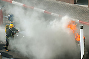 fire fighters puting out the flames with water jets, during a fire fighting drill